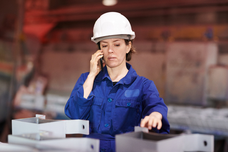 Female Worker Speaking by Phone Stock Photo