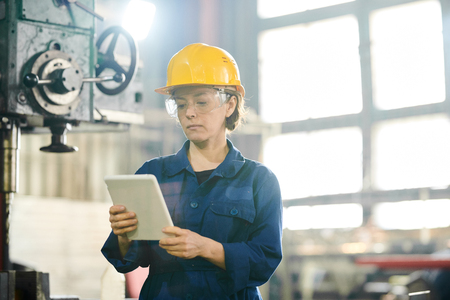 Worker Using Tablet at Factory