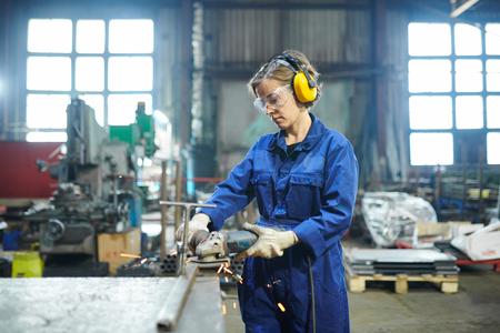 Woman Working in Garage Stock Photo