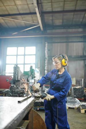 Woman Cutting Metal