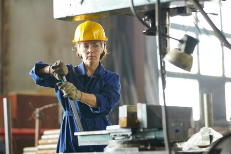 Female Mechanic at Factory Stock Photo