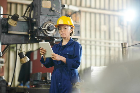 Female Worker Using Tablet at Factory Stock Photo
