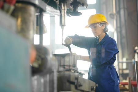 Female Mechanic Repairing Machines