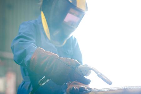 Woman Welding Metal Stock Photo