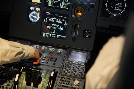 Aviators checking engine systems on flight deck