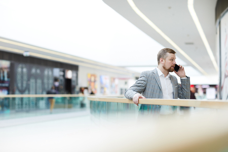 Enterprising man solving work issues on phone