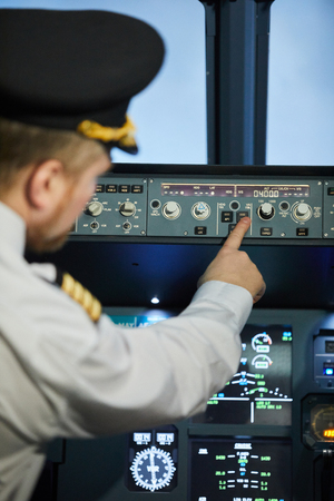 Captain of aircraft pushing button