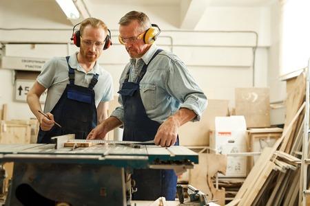 Carpenters Cutting Wood