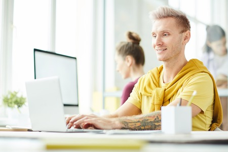 Young Man in Co Working Space Stock Photo