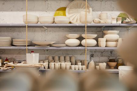 Beautiful dishware on shelves Reklamní fotografie