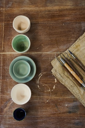 Clay modelling tools and ceramic bowls 스톡 콘텐츠