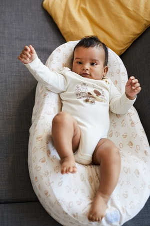 Happy baby boy in cute bodysuit