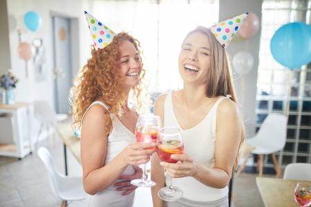 Two Girls Enjoying Party Stockfoto