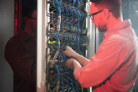 IT specialist maintaining networking system Stock Photo