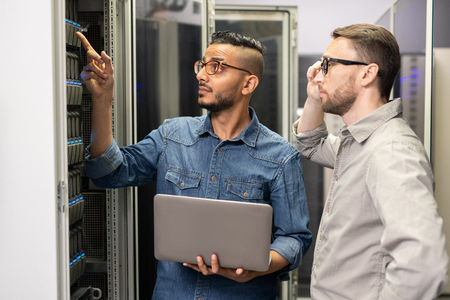 Network engineers working with supercomputer Stock Photo