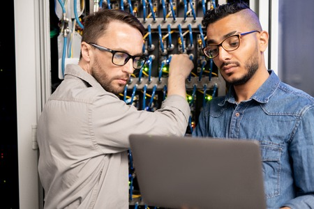 Server specialists testing network system Stock Photo