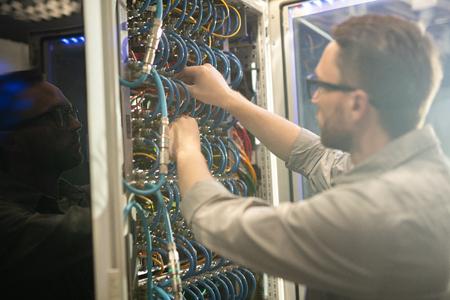 Network engineer fixing server Stock Photo