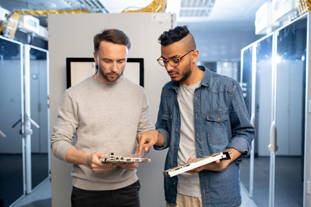Mainframe engineers discussing motherboard Stock Photo