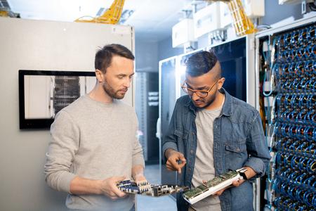 Server engineers doing network upgrades Stock Photo