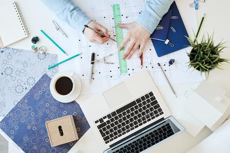 Drawing on blueprint of flat plan