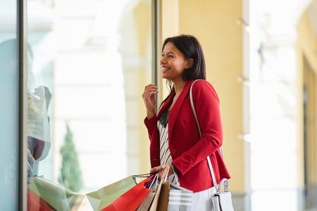 Positive woman enjoying shopping