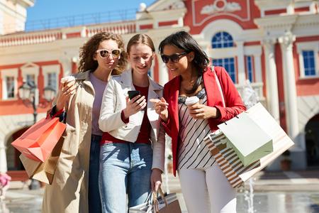 Ladies choosing clothing through mobile app
