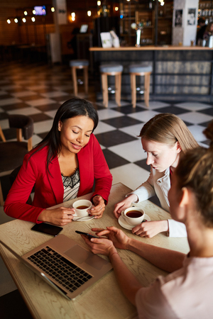 Young women discussing small business ideas Stock Photo