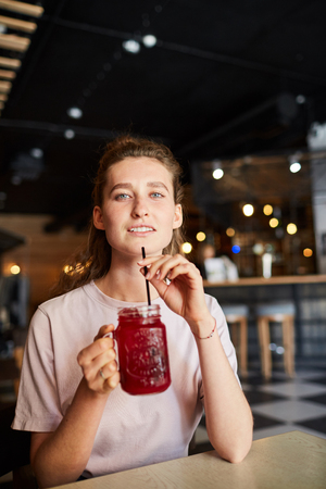 Attractive woman enjoying refreshing smoothie