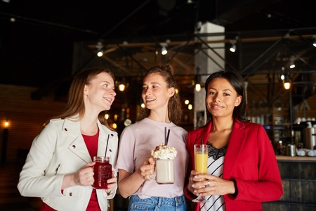 Smiling women with beverages