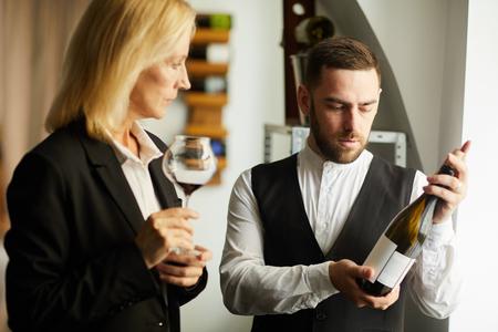 Sommelier Choosing Wine