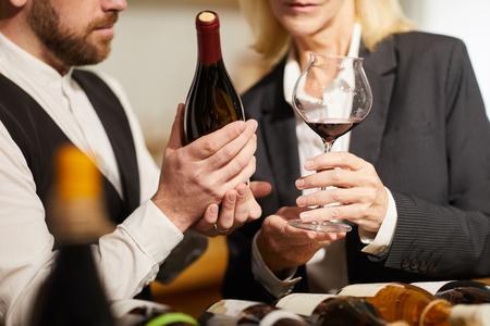 Sommeliers Choosing Wine Closeup