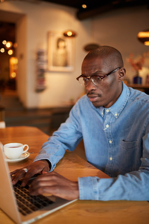 African Businessman Working in Cafe