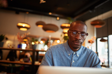 African Businessman Looking at Screen