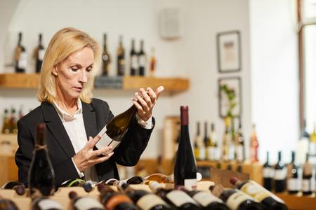 Female Sommelier Choosing Wine