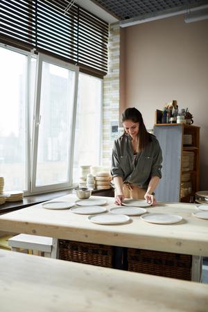 Female Ceramist Working in Studio
