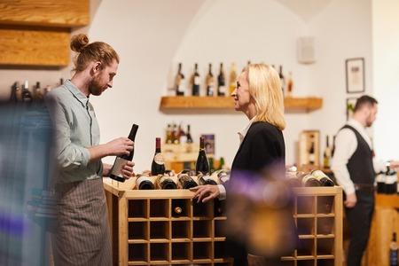 Customer Choosing Wine Imagens
