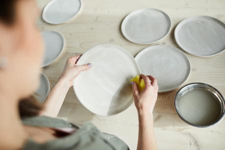 Female Ceramist Making Plates