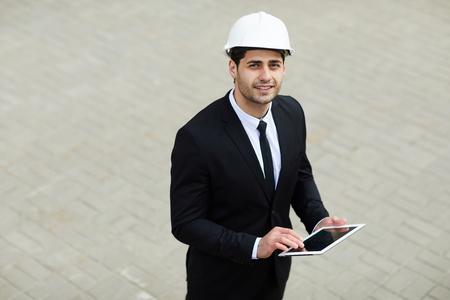 Middle-Eastern Businessman Wearing Hardhat