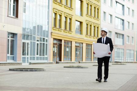 Businessman Inspecting Site