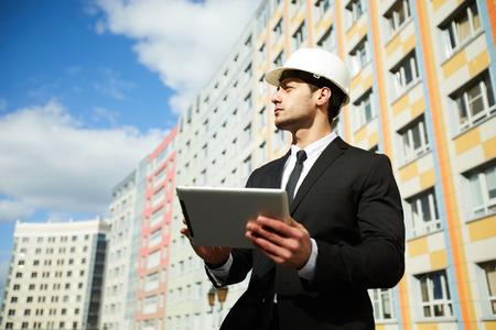 Businessman by Apartment Building