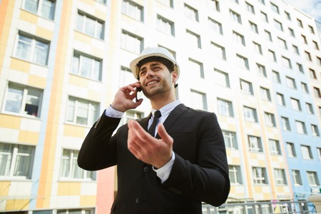 Middle-eastern Mixed Race Businessman by Apartment Building