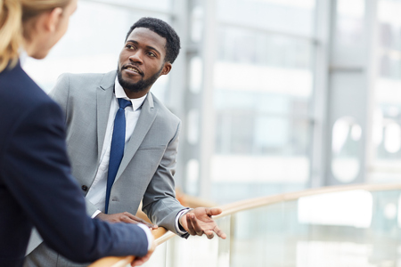 Black businessman discussing project with colleague