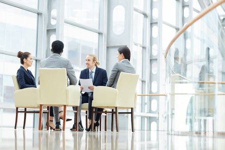 Business experts discussing sales data Stock Photo