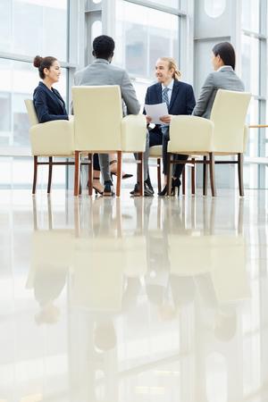 Discussing agenda at meeting