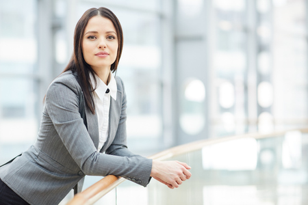 Attractive young businesswoman in office 스톡 콘텐츠