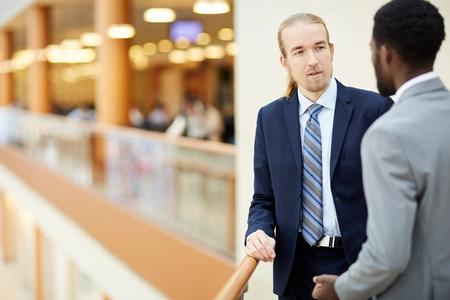 Thoughtful businessmen sharing ideas