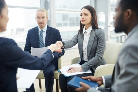Making handshake with investor Stock Photo
