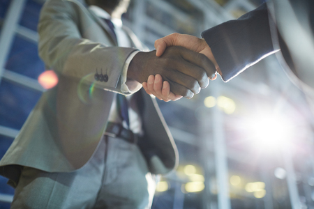 Making handshake after business deal Stock Photo
