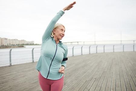 Woman exercising 스톡 콘텐츠
