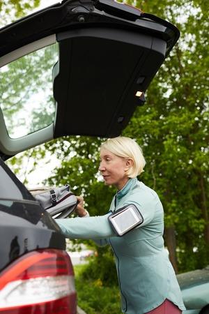 Sportswoman by car